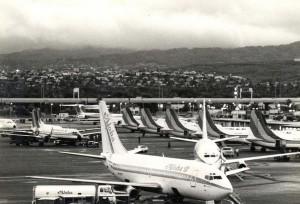 Interisland ramp area, Honolulu International Airport, with Aloha and Hawaiian planes, 1980s.