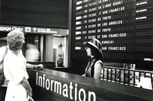 Visitor Information Program desk, Honolulu International Airport, 1980s.