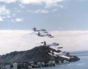 T-33A Shooting Star aircraft of the 15th Air Base Wing, Hickam Air Force Base, Hawaii, fly past Waikiki Beach, 1982.