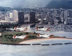 T-33A Shooting Stars from Hickam Air Force Base, Hawaii, fly in formation past Ala Moana Beach and the Waikiki Yacht Club, 1982.