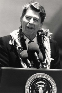President Ronald Reagan speaks to a crowd of more than 4,000 people who gathered at Hickam Air Force Base, Hawaii, Base Operations to greet him upon his arrival in Hawaii, April 26, 1986.