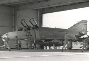 Hawaii Air National Guard alert crews dash to their F-4 aircraft at Hickam Air Force Base, Hawaii, for one last practice scramble before being relieved of the responsibility for defending Hawaii's airspace to the new F-15 Eagles, September 1, 1987.