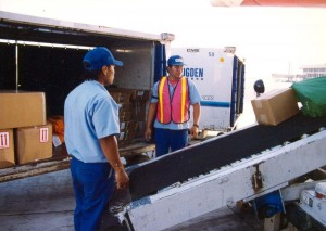Unloading baggage from an interisland plane, Honolulu International Airport, 1994.