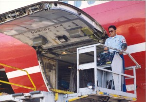 Loading baggage aboard an aircraft, Honolulu International Airport, 1994.