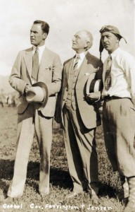 Dole Derby pilots Art Goebel, left, and Martin Jensen, right, with Governor Wallace R. Farrington, at Wheeler Field, August 17, 1927.