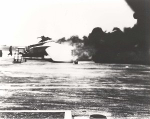 Smoke billows from burning B-17 on Hickam Field flight line, December 7, 1941.