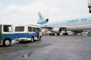 Shuttles arriving at a Korean Air aircraft