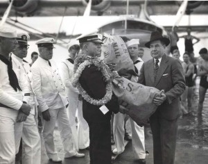 Photo of Pan Am pilot receiving a bag of U.S. Mail to be delivered