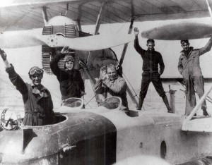 Historic photos of pilots on an airplane