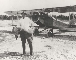 Photo of Fern standing in front of a single propeller plane