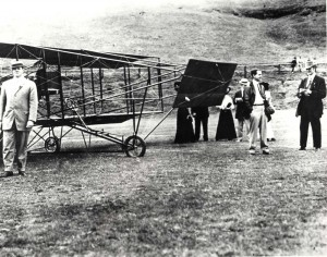 "Historical photo of J.C. ""Bud"" standing next to his aircraft"