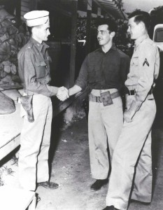 Maj. Charles Stewart (left), 86th Observation Squadron Commander, congratulates Pvt William L. Burt and PFC Ray F. McBriarty who were awarded the Silver Star for Gallantry for December 7, 1941.