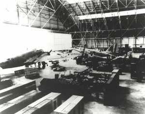 Hangar 35, Hickam Field, with B-18s and a P-26 aircraft in front of the second B-18, c1940-1941.