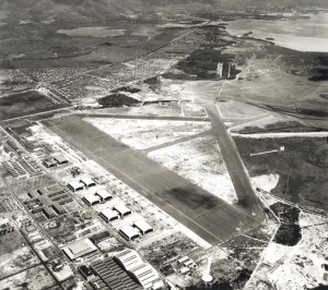Aerial from 3,000 feet shows completed Diamond Head extension of taxiway. Planes are parked closely together on apron for security since sabotage was considered the greatest threat. Two months later the Japanese aerial attack occurred. October 1, 1941.