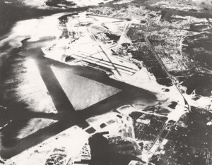 "Naval Air Station Honolulu (John Rodgers Airport), April 1945. Note seaplane runways for flying boats like ""Mars"". Also seen are Hickam AFB runways."