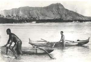 Outrigger canoes at Waikiki Beach, late 1800s.