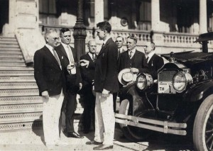 Early automobile at Iolani Palace, Honolulu, 1920s. Bears license plate TH (Territory of Hawaii) 1.