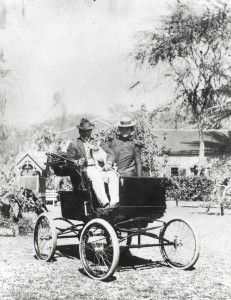 Prince Kuhio and Princess Kalanianaole ride in an automobile in Honolulu, 1920s.