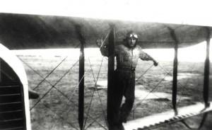 Aviator stands on wings of plane, c1927, Luke Field.