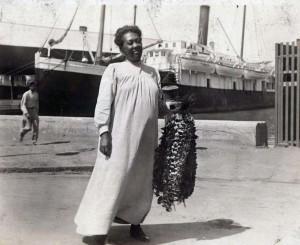 Lei seller greeting passenger ship arrivals at Honolulu Harbor.