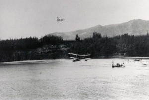 Louis R. Gowans Sr flies his Army plane past Waikiki.