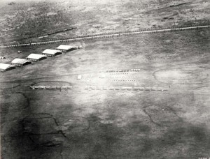 One of the earliest photos of Wheeler Field before completion of permanent hangars. The 17th Cavalry Drill Group was bounded on the north by the Oahu Railroad, on the east by the main road into Schofield Barracks, and on the west and south by gulches. c1922-1923.