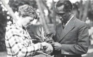 Honolulu Sheriff Duke Kahanamoku shares a pineapple with Amelia Earhart, January 2, 1935 at the Royal Hawaiian Hotel.