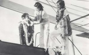 Mildred Mitchell presents a lei to Amelia Earhart while on an interisland tour of Hawaii, while her sister Bernice Mitchell waits with more leis, January 5, 1935.