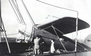 Amelia Earhart Putnam's Lockheed Vega monoplane rests on the deck of the Lurline upon arrival in Hawaii, December 27, 1934.