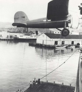 Amelia Earhart's plane swings over the side of the Lurline onto a barge below in Honolulu Harbor, December 27, 1934.