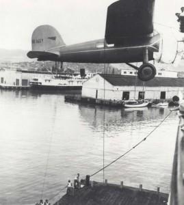 Amelia Earhart's plane swings over the side of the Lurline onto a barge below in Honolulu Harbor, December 27, 1934.