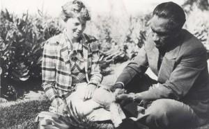 Honolulu Sheriff Duke Kahanamoku shows Amelia Earhart how pineapples are prepared for eating, January 2, 1935 at the Royal Hawaiian Hotel.