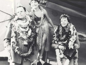 Hula dancer Dorothy Leslie posed between George Putnam, publisher and husband of Amelia Earhart, right, on arrival in Honolulu, December 27, 1934.