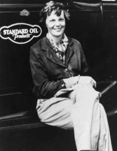 Amelia Earhart sits on the running board of a Standard Oil fueling truck, at Wheeler Field, 1935.