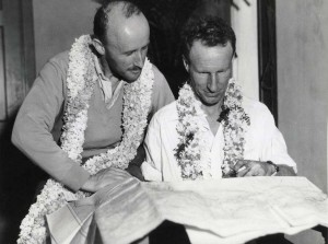 Capt. P. G. Taylor and Charles Kingsford Smith with flight chart for their trans-Pacific flight from Fiji to Wheeler Field, Oahu, October 29, 1934.