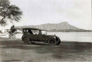 Automobile with Diamond Head and Waikiki in background, 1933.