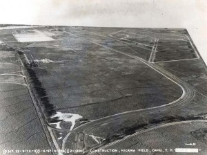 Construction at Hickam Field, January 6, 1937. By the end of 1935 the site was cleared. During 1936, the first phase had been surveyed and cut, railroad tracks and sidings constructed, and freshwater connections installed. Navy censors obliteratred Pearl Harbor. The gate house is in place at the bottom of the photo.