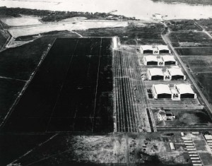 Location of tent city at Hickam Field is clearly shown (lower right hand corner). Base Operations and first four hangars have been completed. Bishop Point dock and submarine net pier are in place and Hangar Avenue extends to Bishop Point, March 31, 1938.