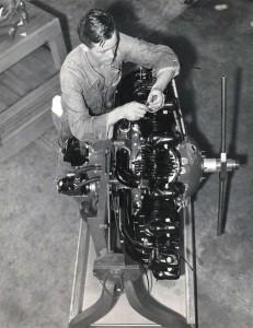 Inter-Island Airways, August 20, 1934. Mechanic H. T. Pollard works on an amphibian engine.