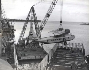 Inter-Island Airways. A Sikorsky S-43 is unloaded from a ship at Honolulu Harbor.