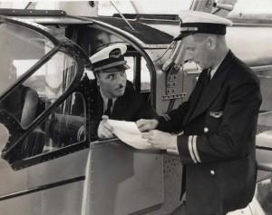 Pilot Ed Mueller receives instructions from Chief Pilot Charles Elliott.