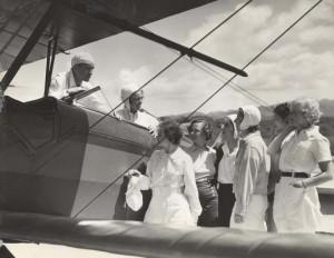 Flying Instructor Olean V. Andrew April 13, 1935. Pilot Andrews, Evelyn Hudson, assistant instructor; Winifred Hudson, Helen Smith, Virginia Thomas, Madeline Hayden, Emma Chung, Clora Curtis.