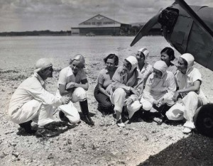 Instructor Olean V. Andrew gives flying lessons to his students, April 13, 1935.