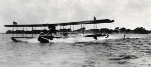 Water skiing behind an amphibian plane in Pearl Harbor, 1930s.