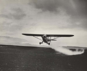 Crop dusting by air, Honolulu, 1930s.