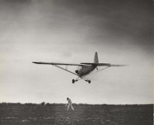 Crop dusting by airplane, Honolulu, 1930s.