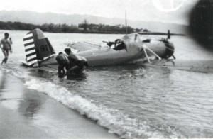 A-12 being removed from Haleiwa Bay after a forced landing. The pilot was Ssgt. Charlie Cunningham. The gunner was PFC Johnny DiLauro. Both survived. Only the guns were damaged. July 19, 1938.