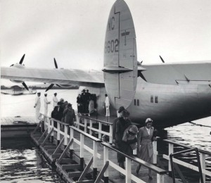Fifteen hours after departing San Francisco, 25 passengers disembark from Pan American's California Clipper at Honolulu marking the end of the 2,400 mile inaugural flight of the giant Boeing plane with a payload of passengers.