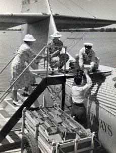 Library of Hawaii and Pan American Airways staff load books onto the China Clipper for delivery to Midway and Wake Islands. June 1936