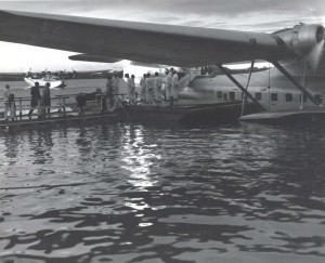 The first trans-Pacific air passengers boarding the Pan American Hawaii Clipper to continue their flight across the Pacific. In the background is the China Clipper.